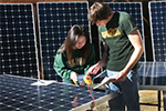 Students with photovoltaic panels for Cal Poly San Luis Obispo